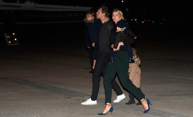 Ivanka Trump, daughter of US President Donald Trump, her husband Jared Kushner, senior White House adviser, and their children walk off Air Force One at Andrews Air Force Base in Maryland on February 12, 2017 as they return from Florida with the president. / AFP / NICHOLAS KAMM