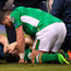 Seamus Coleman is comforted by teammate Shane Long of Republic of Ireland after picking up an injury during the FIFA World Cup Qualifier Group D match between Republic of Ireland and Wales at the Aviva Stadium in Dublin. Photo by Brendan Moran/Sportsfile