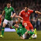 Dublin , Ireland - 24 March 2017; Sam Vokes of Wales is tackled by John O'Shea of Republic of Ireland during the FIFA World Cup Qualifier Group D match between Republic of Ireland and Wales at the Aviva Stadium in Dublin. (Photo By Ramsey Cardy/Sportsfile via Getty Images)