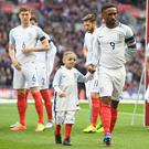 Jermaine Defoe of England and England mascot Bradley Lowery line up prior to the England and Lithuania game at Wembley. (Photo by Michael Regan - The FA/The FA via Getty Images )