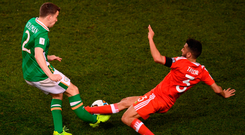 Neil Taylor tackles Seamus Coleman in the incident in which the Irish defender broke his leg. Photo by Stephen McCarthy/Sportsfile