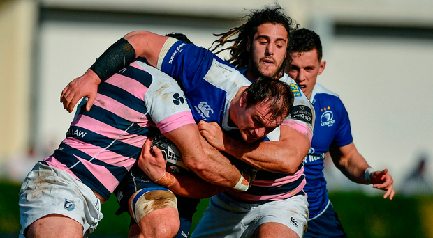 Rhys Ruddock is tackled by George Earle during Saturday's Pro 12 match at the RDS. Photo by Ramsey Cardy/Sportsfile