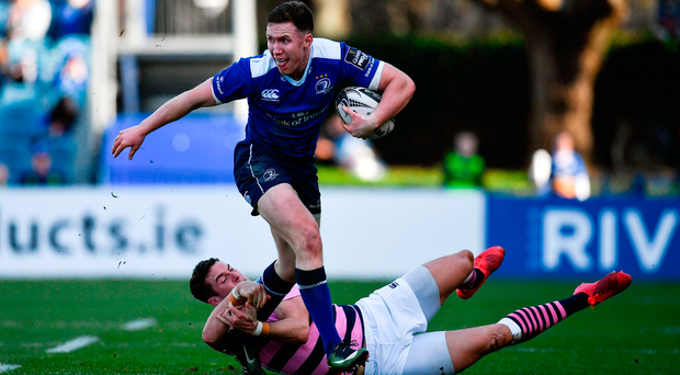 Rory O'Loughlin of Leinster is tackled by Steven Shingler of Cardiff Blues. Photo by Ramsey Cardy/Sportsfile
