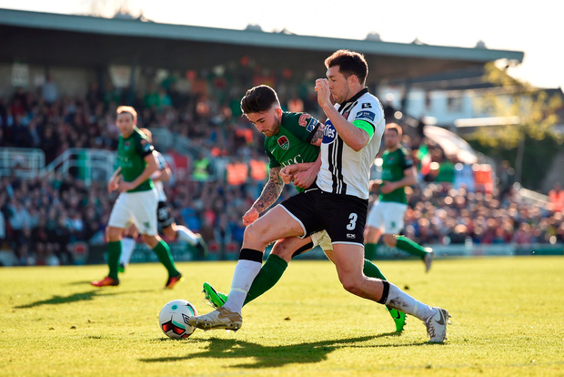 Sean Maguire of Cork City in action against Brian Gartland of Dundalk. Photo by Diarmuid Greene/Sportsfile