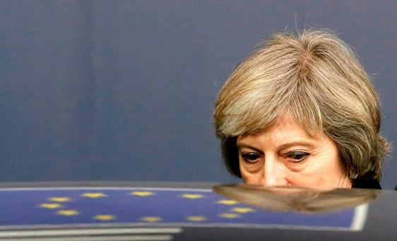 Britain's Prime Minister Theresa May leaves a EU Summit in Brussels last December. Photo: REUTERS