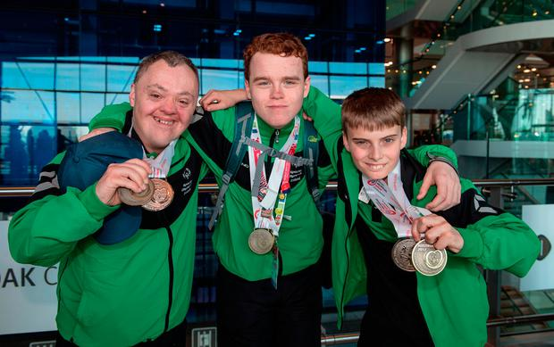 Fellow Skiability Special Olympics Club members Sean McCartan, left, from Carryduff, Co Antrim, and Caolan McConville, from Aghagallon, Co Armagh, with their medal haul Photo: Ray McManus/Sportsfile