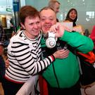 Skiability Special Olympics Club member Cyril Walker from Markethill, Co Armagh, is welcomed home by his sister Annette McMahon at Dublin Airport yesterday Photo: Damien Eagers