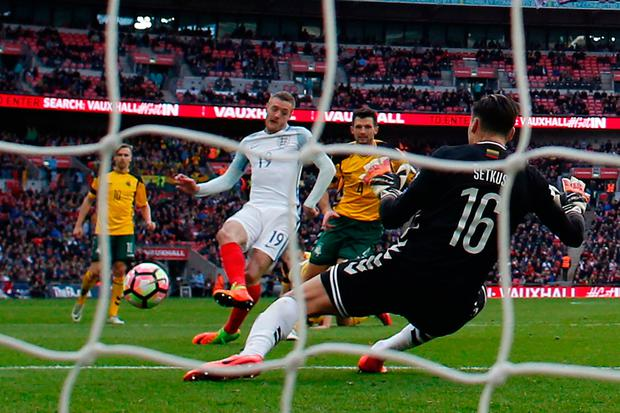 England's striker Jamie Vardy (centre left) shoots past Lithuania's goalkeeper Ernestas Setkus to score their second goal. Photo: Getty Images