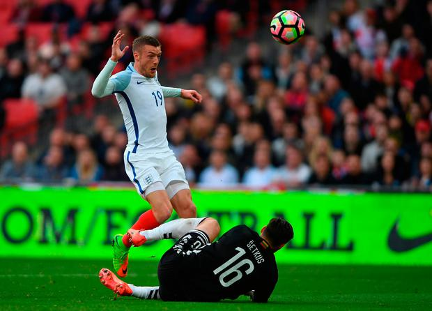 Jamie Vardy of England is closed down by Ernestas Setkus of Lithuania. Photo by Mike Hewitt/Getty Images