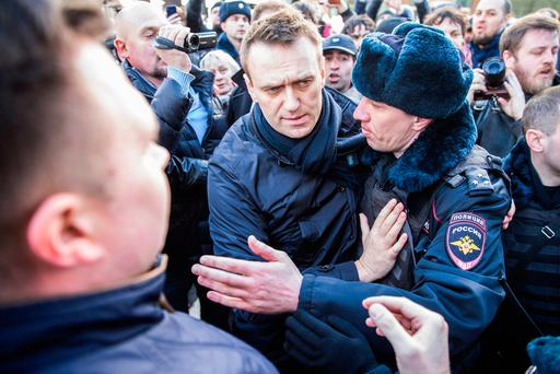 Russia's leading opposition figure Alexei Navalny is detained by police in downtown Moscow during a mass protest in March 2017 Photo: AP