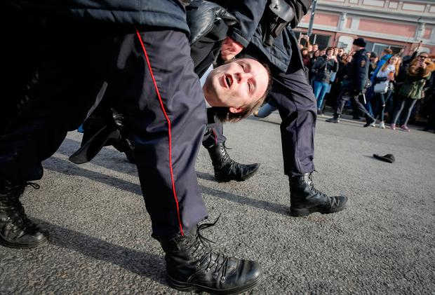 Police drag away a protester. Photo: REUTERS