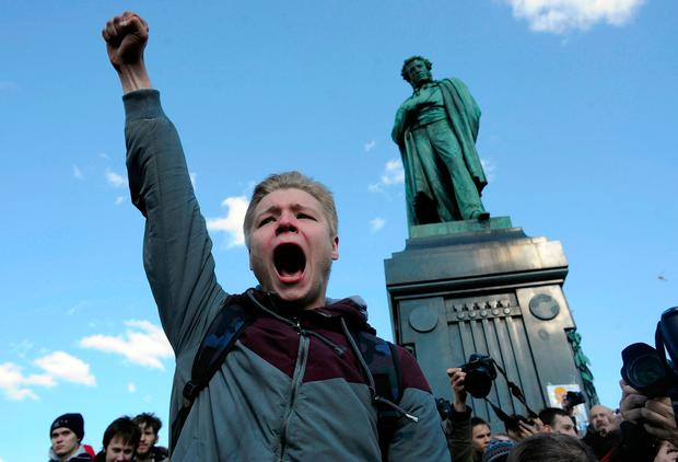A man shouts anti-government slogans in downtown Moscow. Photo: AP