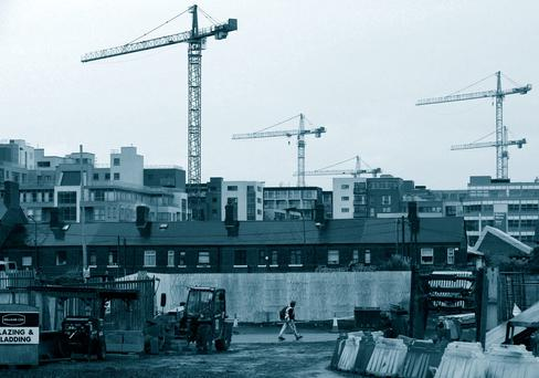 Cranes dot the Dublin skyline during the construction boom of the Celtic Tiger era. Stock picture