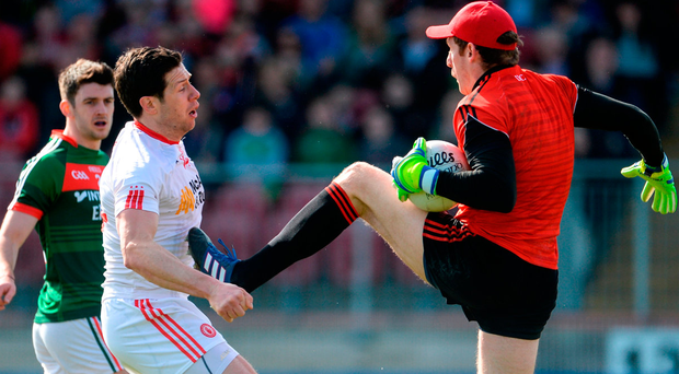 David Clarke of Mayo and Tyrone's Sean Cavanagh (left) clash in Omagh. Photo: Oliver McVeigh/Sportsfile