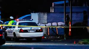 A body is removed from the Cameo club in Cincinnati. Photo: John Minchillo/AP