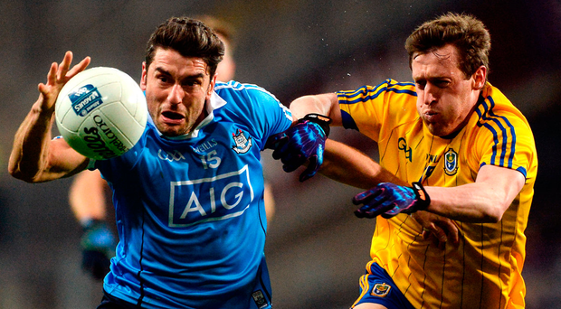 Dublin's Bernard Brogan, on his first start of the year, tries to escape the clutches of Conor Devaney on Saturday night. Photo: Daire Brennan/Sportsfile