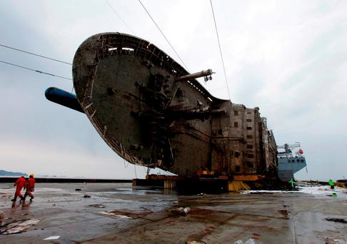 The sunken Sewol ferry lies sideways on a transport vessel after being raised from the seabed during the salvage operation in waters off the southern island of Jindo. Photo: GETTY