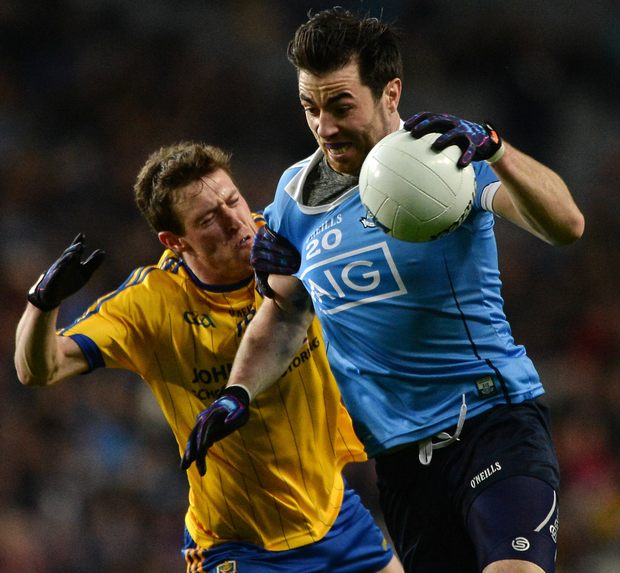 Dublin's Michael Daragh MacAuley in action against Conor Devaney of Roscommon. Photo: Daire Brennan/Sportsfile