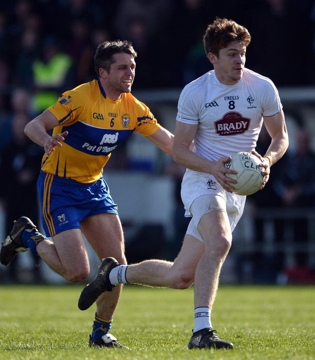 Kevin Foley of Kildare in action against Gordon Kelly of Clare. Photo: Daire Brennan/Sportsfile
