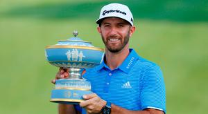 Dustin Johnson of the United States holds up The Walter Hagen Trophy after beating Jon Rahm of Spain in the final round of the World Golf Classic - Dell Match Play golf tournament at Austin Country Club. Credit: Erich Schlegel-USA TODAY Sports