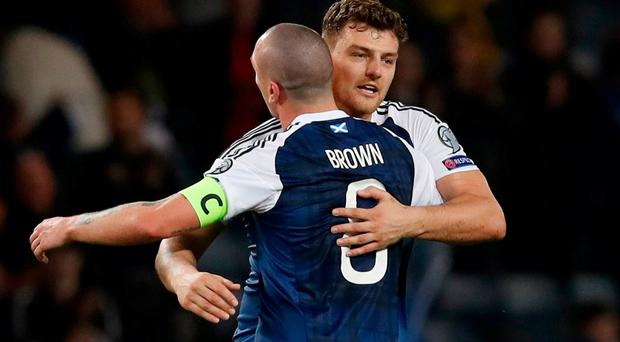 Scott Brown and Chris Martin celebrate after the match. Reuters / Russell Cheyne