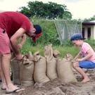 Residents fill sandbags in preparation for the arrival of Cyclone Debbie in the northern Australian town of Bowen, located south of Townsville March 27, 2017. Photo: AAP/Sarah Motherwell/via REUTERS