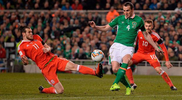 John O'Shea of Republic of Ireland in action against Gareth Bale of Wales during the FIFA World Cup Qualifier Group D match between Republic of Ireland and Wales at the Aviva Stadium in Dublin. Photo by Eóin Noonan/Sportsfile Photo by Eóin Noonan/Sportsfile