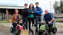 The Shalvey family, Geraldine, Colm, Aoife, Enda and Patrick with dog Nala on their farm at Maudabawn, Co Cavan. Photo: Lorraine Teevan