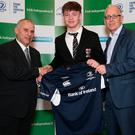 Ruadhan Byron, Belvedere College is presented with his jersey by Tony Ward, Irish Independent and Padraic Brennan, Bank of Ireland, Leinster Schools Rugby Top 15 players of the year, the House of Lords, Bank of Ireland on College Green. Photo: Damien Eagers
