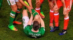 Jon Walters, Shane Long, along with Wales' pair Joe Ledley and Ben Davies attend to the injured Seamus Coleman on Friday. Photo: Stephen McCarthy/Sportsfile