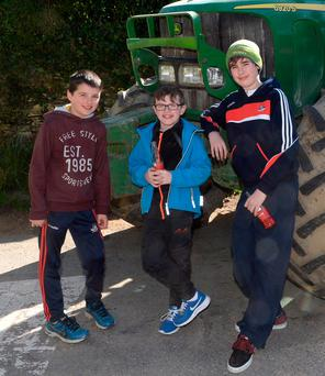 Shane Clancy, Donnacha Keohane and Cathal McCarthy with a John Deere 6920 at the annual tractor run at Ballygurteen, West Cork. Photo: Denis Boyle