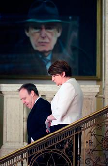 DUP leader Arlene Foster arrives to speak to the media at Stormont yesterday, with DUP deputy leader Nigel Dodds Photo: Niall Carson/PA Wire