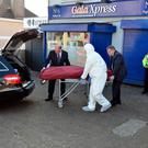 The body of Nicola Collins (left), who was found dead in a flat at Popham's Road in Cork, is removed from the scene Picture: Michael Mac Sweeney/Provision