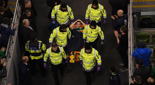Seamus Coleman of Republic of Ireland is stretchered off during the FIFA World Cup Qualifier Group D match between Republic of Ireland and Wales at the Aviva Stadium in Dublin. (Photo By Stephen McCarthy/Sportsfile via Getty Images)