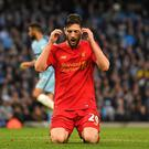 Adam Lallana of Liverpool reacts after missing a chance to score against Manchester City. (Photo by Laurence Griffiths/Getty Images)