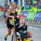 James Casserly and his trainer Mark Lacey completing the 2-16 Dublin marathon (Image: Sportsfile)