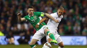 DUBLIN, IRELAND - MARCH 28: Robbie Brady of Republic of Ireland challenges Rurik Gislason of Iceland during the International Friendly match between Republic of Ireland and Iceland at Aviva Stadium on March 28, 2017 in Dublin, Ireland. (Photo by Ian Walton/Getty Images)