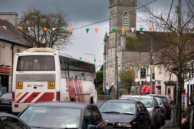 A schoolbus travels down the main street in Athboy. Photo: Tony Gavin