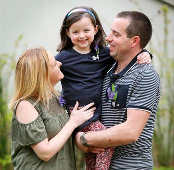 Transplant recipient Lexi Murphy, from Co Waterford, with her parents, Kim and Declan. Photo: Conor McCabe