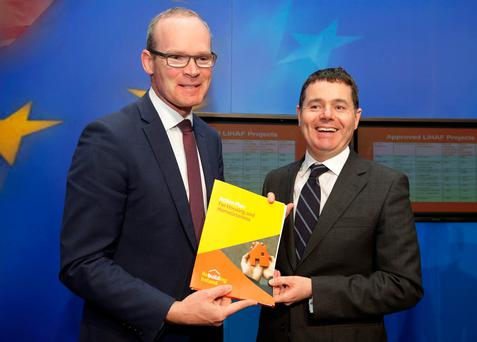 Ministers Simon Coveney and Paschal Donohoe at the announcement of details of the €200m Local Infrastructure Housing Activation Fund yesterday. Photo: Damien Eagers