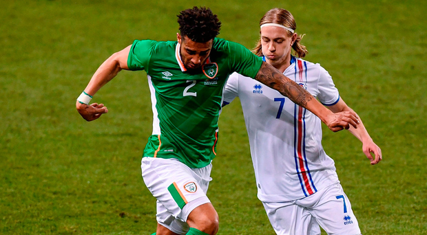Cyrus Christie in action against Elias mar Omarsson. Photo: Sportsfile