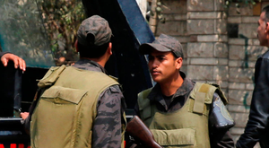 Police officers stand guard at the scene of an explosion in the Cairo suburb of Maadi, last weekend. Photo: Reuters