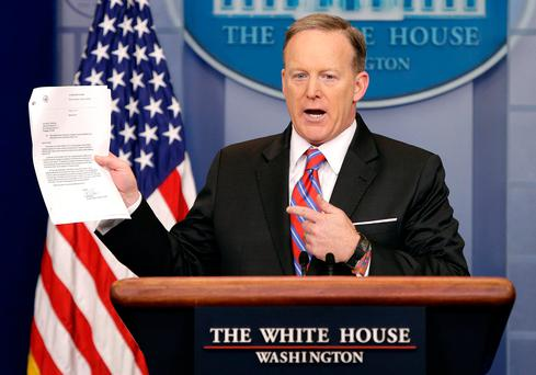 White House press secretary Sean Spicer holds a letter about former acting attorney general Sally Yates's ability to testify to a Congressional investigation into Russian links with the Trump campaign. Photo: Reuters/Joshua Roberts