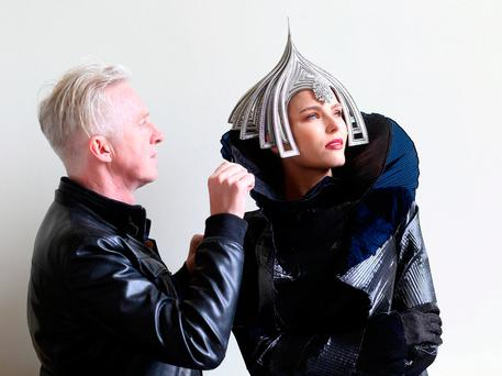 Philip Treacy with model Sarah Morrissey wearing one of his creations