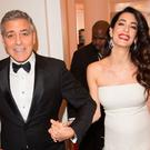 George Clooney and Amal Clooney attend the Cesar Film Awards 2017 ceremony at Salle Pleyel on February 24, 2017 in Paris, France. (Photo by Stephane Cardinale - Corbis/Corbis via Getty Images )