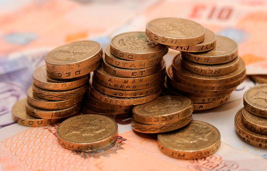 The pound was down 0.4pc against the US dollar at 1.24