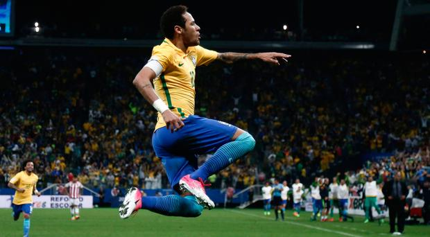 Brazil forward Neymar celebrates after scoring against Paraguay during their 2018 FIFA World Cup qualifier football match in Sao Paulo. / AFP PHOTO / Miguel SCHINCARIOLMIGUEL SCHINCARIOL/AFP/Getty Images