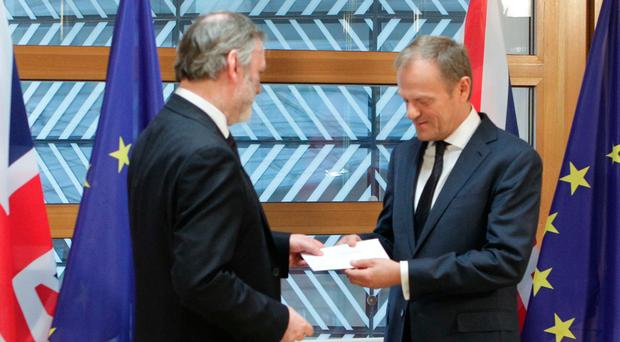 Britain's Ambassador to the EU, Sir Tim Barrow hand delivers Prime Minister Theresa May's Brexit letter in notice of the UK's intention to leave the bloc under Article 50 of the EU's Lisbon Treaty to EU Council President Donald Tusk, in Brussels, Belgium. Photo: Alexander Britton/PA Wire