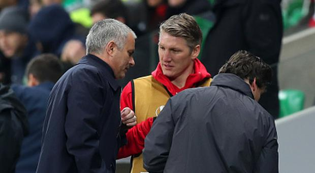 Bastian Schweinsteiger of Manchester United speaks with Jose Mourinho, manager of Manchester United. (Photo by Christopher Lee/Getty Images)