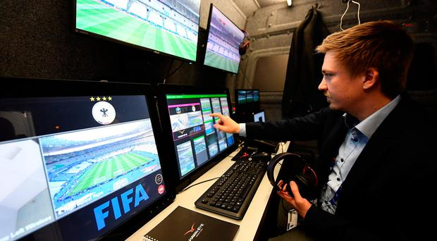 A technician checks the video arbitration system that will be used during the friendly football match France vs Spain. / AFP PHOTO / FRANCK FIFEFRANCK FIFE/AFP/Getty Images